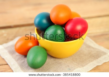 bright easter eggs on wood