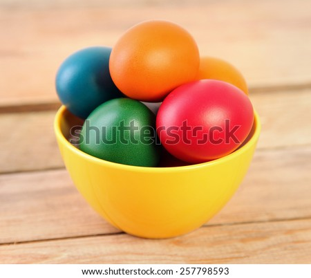 bright easter eggs on wooden background