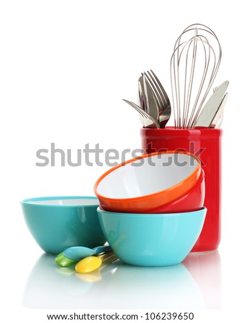 bright empty bowls, cups and kitchen utensils isolated on white - stock photo