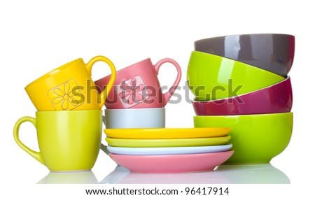 bright empty bowls, cups and plates isolated on white - stock photo