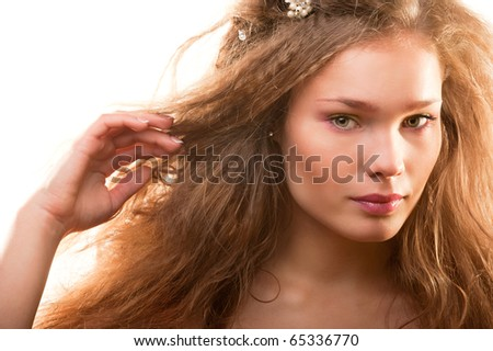 Bright fashion portrait of beautiful young woman on white