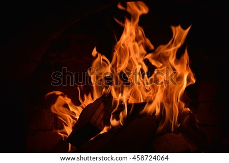 Bright flame in the fireplace