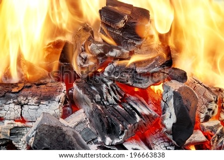Bright Flames and Glowing Coals in BBQ or Fireplace. - stock photo
