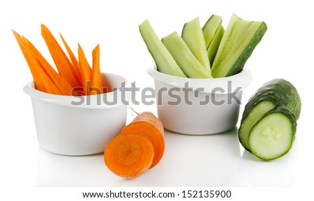 Bright fresh carrot and cucumber cut up slices in bowl isolated on white