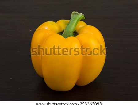 Bright fresh Yellow Bulgarian Pepper on wood background