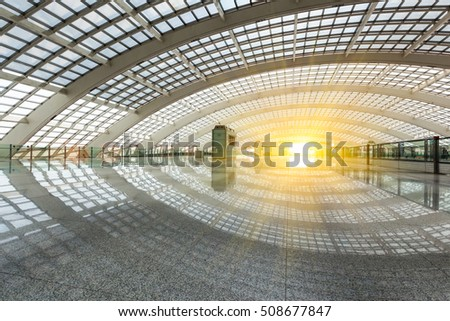 bright futuristic building of airport express train station in beijing, China