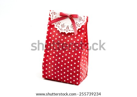 bright gift bags and gifts box isolated on white - stock photo