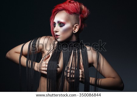 bright girl with red hair and unusual make-up