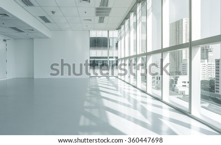 Bright glass wall office building with city view and reflect shadow for  background