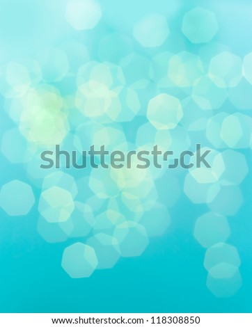 Bright glowing blue abstract background in the form of bokeh - stock photo