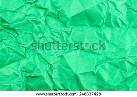 Bright green background texture of folded paper - stock photo