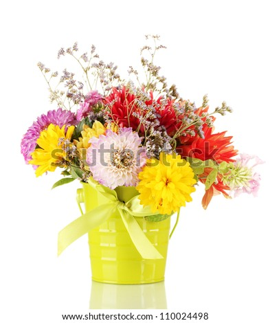 Bright green bucket with flowers isolated on white - stock photo