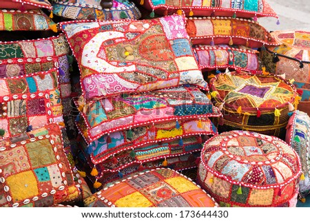 Bright handmade pillows selling on a local asian market in Abu Dhabi - stock photo