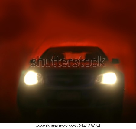 Bright headlights on car. Red background  - stock photo