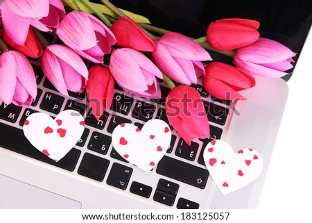 Bright hearts and flowers on computer keyboard close up