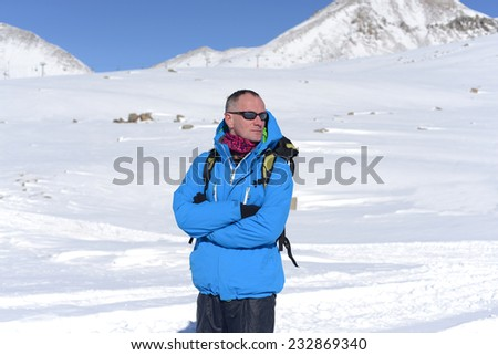 Bright hiker in winter mountains - stock photo