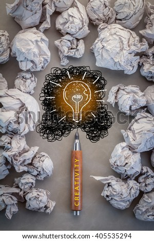 bright idea concept with crumpled paper and bulb drawing on grey blackground.jpg - stock photo