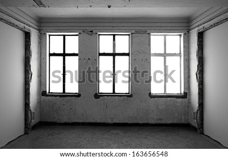 Bright illumination from three windows in an abandoned building.  - stock photo