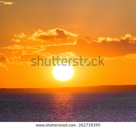 Bright Illumination Sunrise over Water  - stock photo