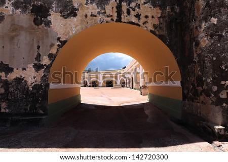bright interior of El Morro Fort  visible through tunel ,  San Juan, Puerto Rico - stock photo