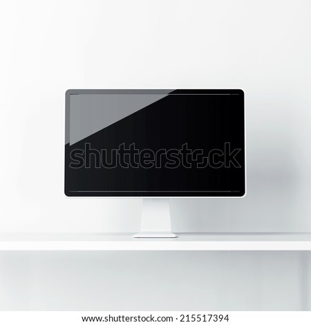 Bright interior with computer display on a table - stock photo