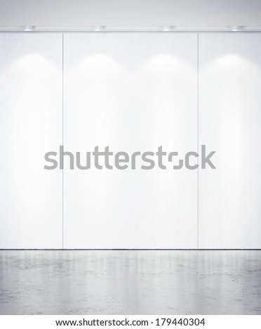Bright interior with spotlights on a wall - stock photo