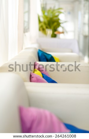Bright interior with white sofa with colorful pillows - stock photo