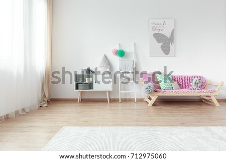 Bright Kid Room With Colorful Pillows On Couch And Simple Grey Poster On  White Wall