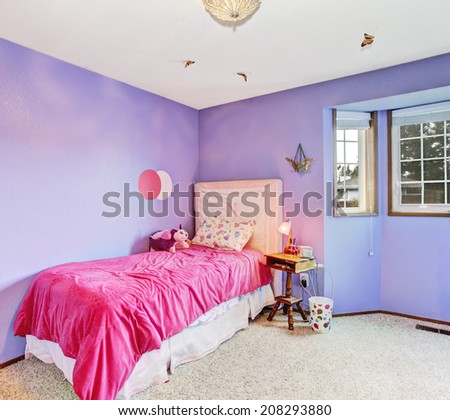 Bright kids room interior in light lavender with soft carpet floor and pink bed - stock photo