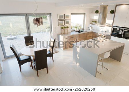Bright kitchen and dining room in modern design - stock photo