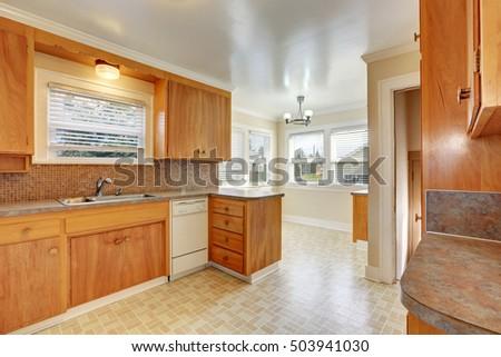 Bright Kitchen Room With Old Style Wooden Cabinets, Linoleum Floor.  Northwest, USA