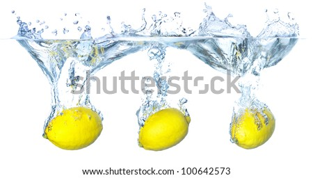 Bright lemons and water splash. Healthy food and active life