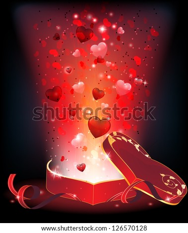 Bright light and fireworks with hearts from an open box of chocolates. Valentines Day abstract background. - stock photo