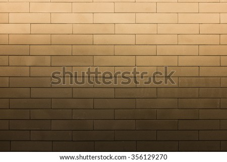 bright light flood on top of brown texture brick wall pattern - stock photo
