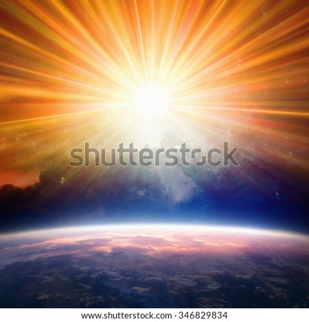 Bright light from above shines on planet Earth. Elements of this image furnished by NASA nasa.gov - stock photo