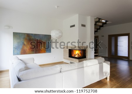 Bright living room with fireplace, stylish house - stock photo