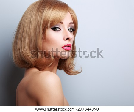 Bright makeup. Blond short hair female model with pink lipstick. Closeup portrait - stock photo