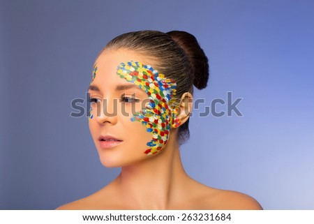 bright makeup unusual colored dots - stock photo