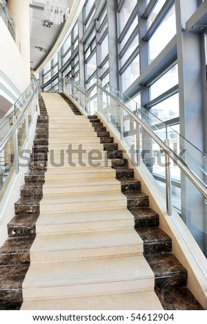 Bright, marble staircase in high building. - stock photo