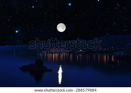 bright moon illuminates  sea shore. Night  on resort - stock photo