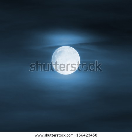 Bright moon in blue foggy sky, halloween background - stock photo