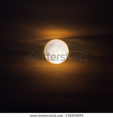 Bright moon in brown sky - stock photo
