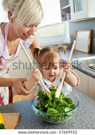 Bright mother and child cooking in the kitchen