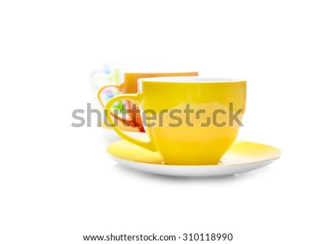 Bright multi colored cups on a white background.