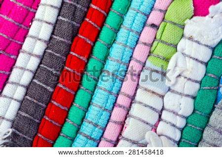 Bright multi-colored striped background thread and fabric - stock photo