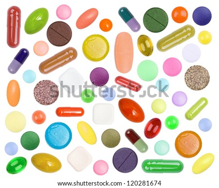 Bright multi-colored tablets on the white - stock photo