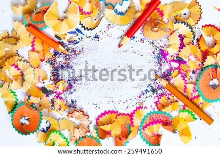 bright multicolored pencil shavings and copy space, still life - stock photo