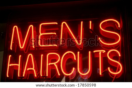 Bright Neon sign offering metal haircuts