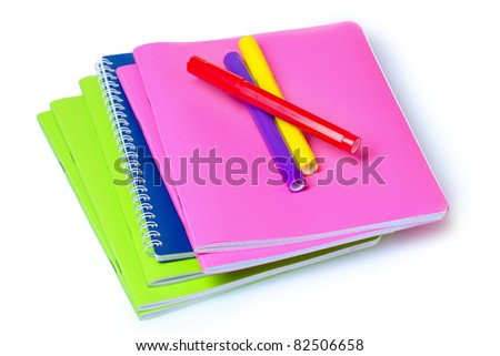bright notebooks and markers isolated on white - stock photo