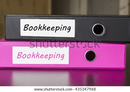 Bright office folders over dark background and bookkeeping text concept - stock photo